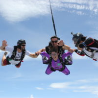 woman in purple jumpsuit makes first ever tandem skydive