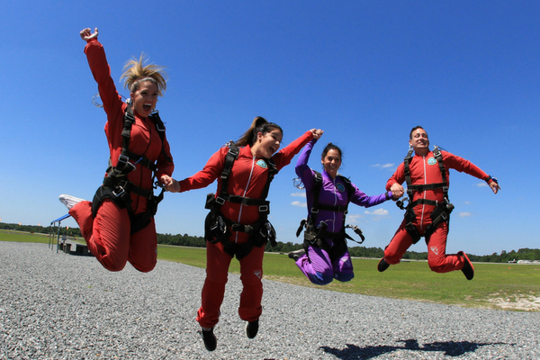 first time tandem students jump with joy after making their first skydive at Skydive DeLand