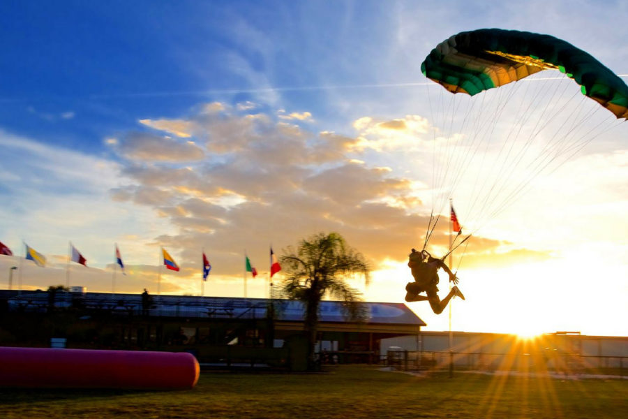 experienced skydiver swoops into landing area at Skydive DeLand at sunset