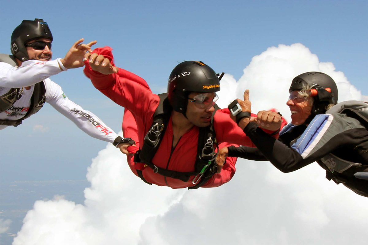 aff skydiving student in flight with 2 instructors