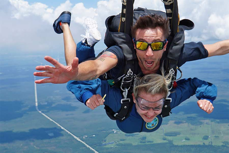tandem skydiving instructor with sunglasses having fun in freefall