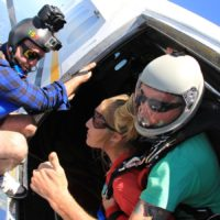woman looks out before making first ever skydive