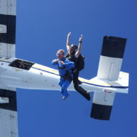first time tandem jumper exits plane with instructor